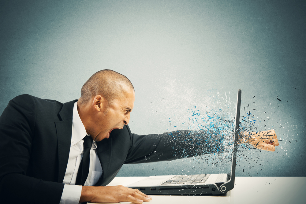 Man Angry With His Computer Because His Online Reputation Has Been Ruined With Multiple Complaints