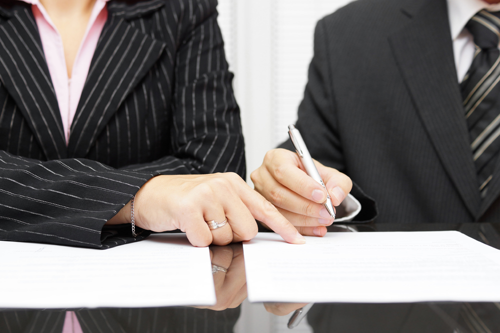 Business Lawyers Drafting Papers