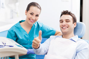 Friendly Dentist and Happy Patient