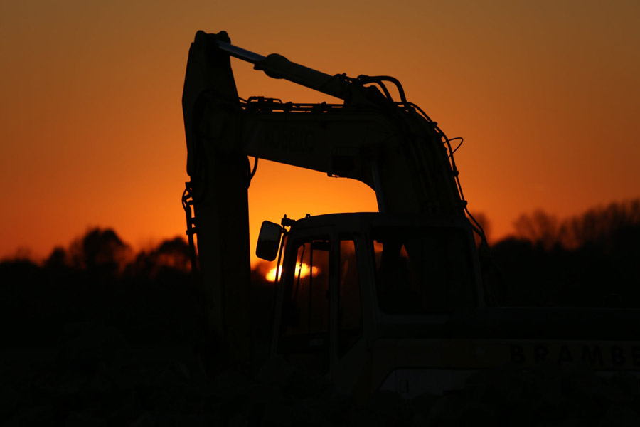 excavator with sunset background