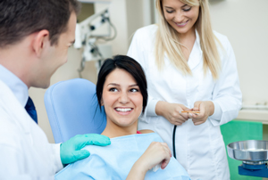 girl getting dental cleaning