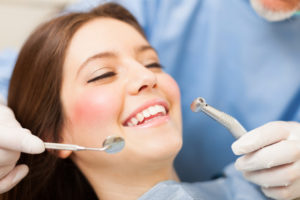 Girl getting a dental cleaning