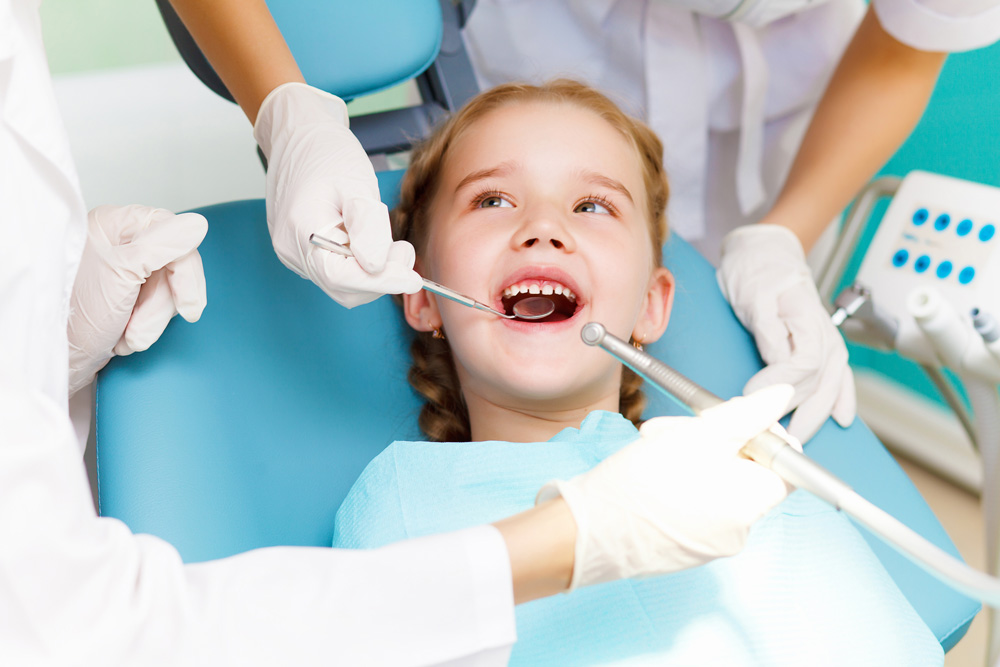 little girl getting dental exam