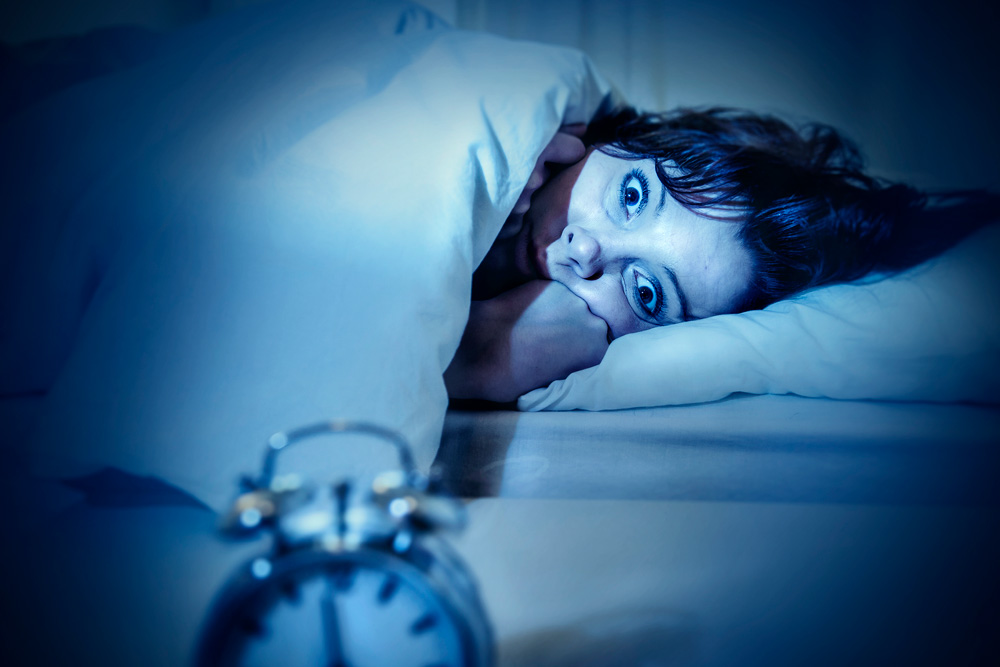 Woman Watching The Alarm Clock - Sleep Hygiene