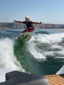 person on wake surf board