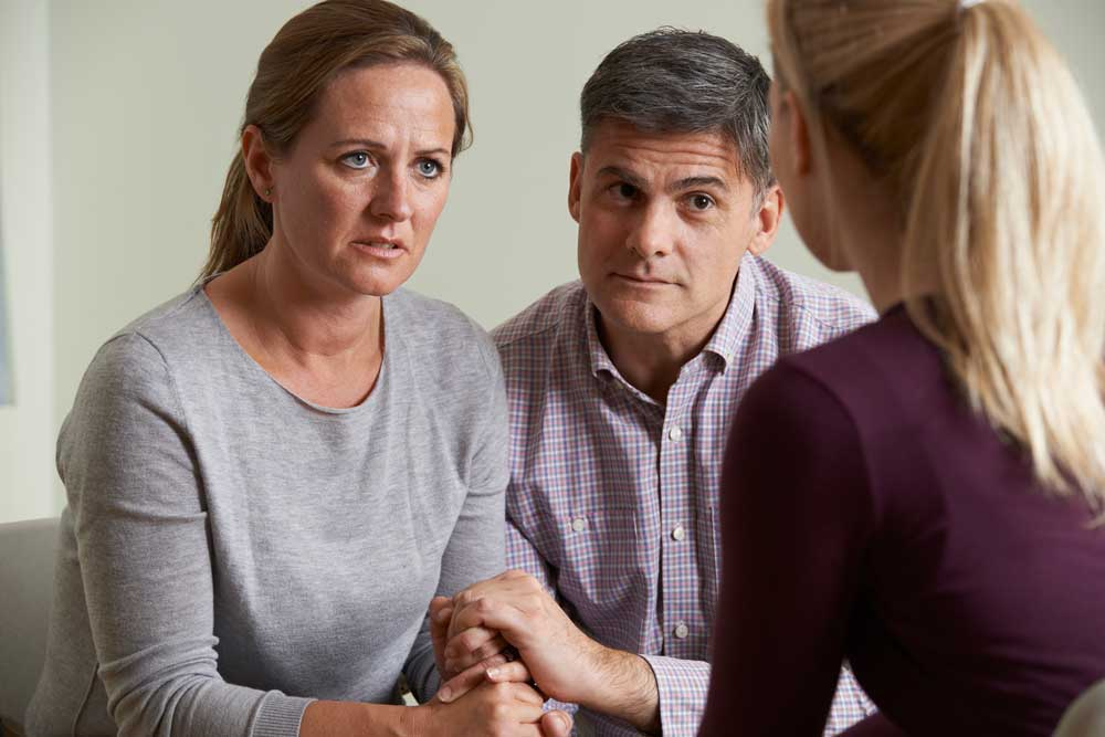 Unhappy couple in marriage counseling