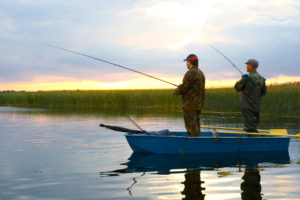 two guys fishing in fishing boat
