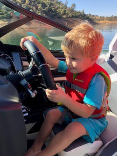 baby driving a boat