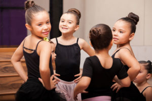 young ballet dancers in black leotards