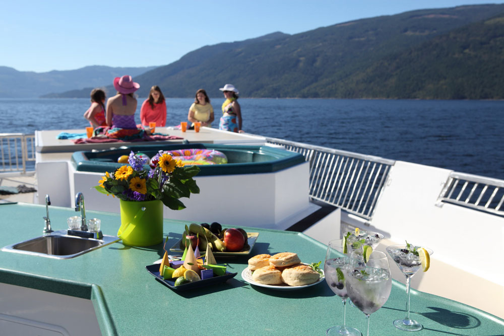 Top Deck of Houseboat with friends and food
