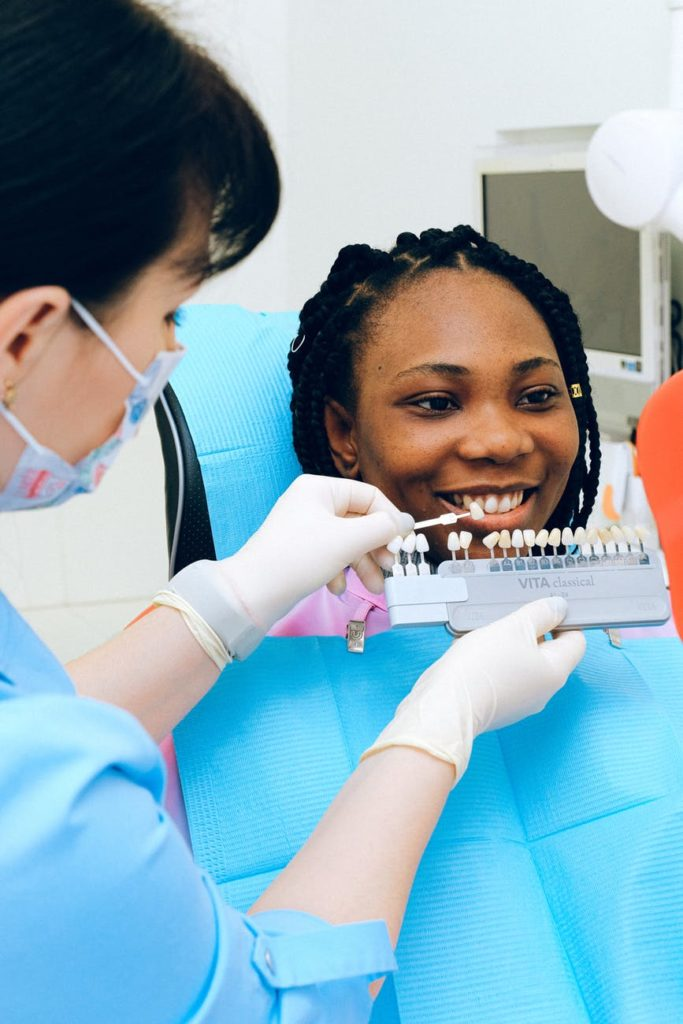 woman holding up different colors of teeth