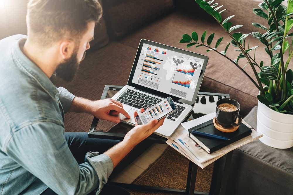 Man looking at his digital marketing and digital agency data tables