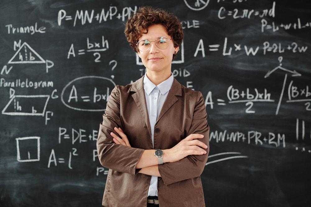 Teacher standing in front of a chalkboard
